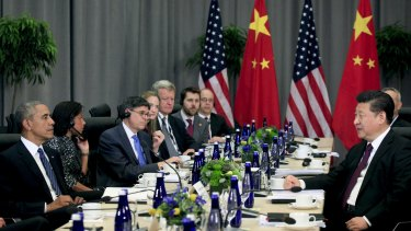 US President Barack Obama and his Chinese counterpart Xi Jinping speak at a bilateral meeting during the Nuclear Security Summit in Washington.