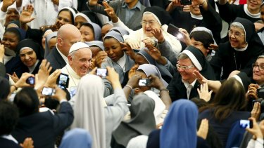 Pope Francis arriving for a special audience on Saturday at the Vatican with the nuns of the Rome's diocese.