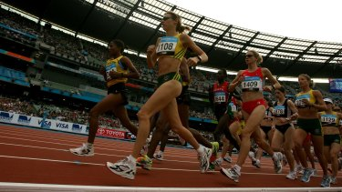 Kerryn McCann leads the field at the start of the marathon in the MCG.