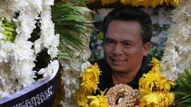 A wreath with a framed picture of murdered Cambodian commentator Kem Ley.