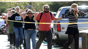 Students, staff and faculty are evacuated from Umpqua Community College in Roseburg on Thursday.