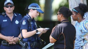 Australian police speak to people near  where eight children were found dead in Cairns.