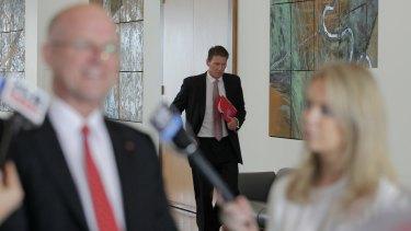 Senator Cory Bernardi arrives to listen in.