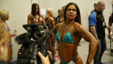 A still from Destination Arnold, a new SBS show about the road to the Arnolds, a female bodybuilding competition.