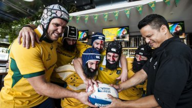 Former Wallaby Ben Alexander with The Dock staff dressed as Wallaby Scott Fardy up against chef Jon ''Kiwi Jon'' Turner in the lead-up to the Rugby World Cup final on November 1.