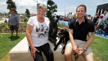 Charlene Simpson poses with real life and statue Sarbi, the Australian Special Forces explosives detection dog, and her son, handler Warrant Officer David Simpson.