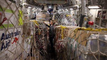 Foreign Minister Julie Bishop inspects Australian aid supplies bound for Vanuatu in March.