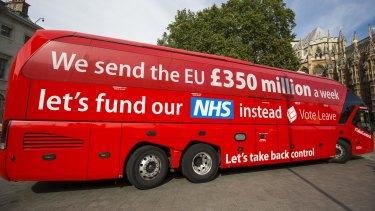 A ''Vote Leave'' battle bus is parked outside the Houses of Parliament in Westminster by Greenpeace before being rebranded on July 18.