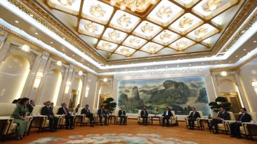 China's President Xi Jinping (4th from the right) and guests at the Asian Infrastructure Investment Bank (AIIB) launch ceremony at the Great Hall of the People in Beijing last October.