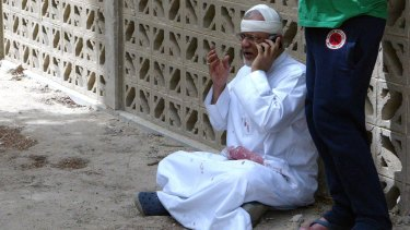 A man at the site of a suicide bombing at a mosque in Kuwait City.