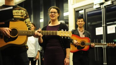 Songs of joy: Olivia Swift leading CHOIR Canberra at the ANU School of Music.