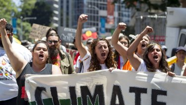 Demonstrators protest in Brisbane over climate change   ahead of the G20.