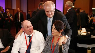 Treasurer Scott Morrison with his brother-in-law Garry Warren and his wife Michelle Warren.