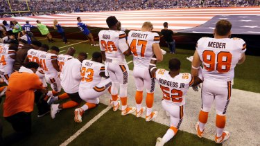 Members of the Cleveland Browns take a knee during the national anthem.