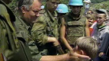 Bosnian Muslim boy Izudin Alic is patted on the head by Ratko Mladic in 1995 as Mladic assures him that everyone in Srebrenica would be safe.