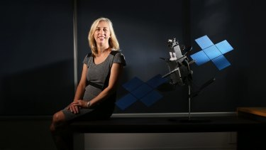 Satellite architect Julia Dickinson with a model of the broadband satellite.