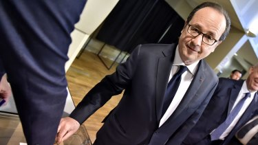 French president Francois Hollande casts his ballot on Sunday.