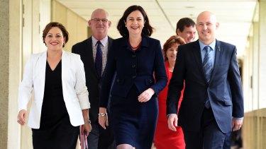 Queensland Deputy Premier Jackie Trad, Queensland Premier Annastacia Palaszczuk and Treasurer Curtis Pitt arrive at Parliament House in Brisbane.
