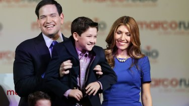 Marco Rubio holds up his son Anthony while his wife Jeanette looks on after announcing his run for the Republican presidential nomination. He is in many ways a traditional Republican.