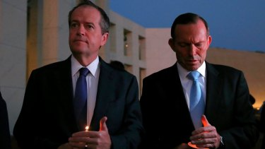 Opposition Leader Bill Shorten and Prime Minister Tony Abbott during a candlelight vigil for Andrew Chan and Myuran Sukumaran on the forecourt of Parliament House in Canberra.