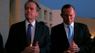 Opposition Leader Bill Shorten and Prime Minister Tony Abbott during a candlelight vigil in February.