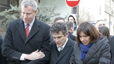 Journalist and doctor Patrick Pelloux (centre), New York City mayor Bill de Blasio and Paris mayor Anne Hidalgo stand united outside the <i>Charlie Hebdo</i> offices in January.