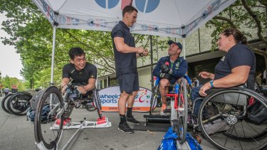 Ricky Stuart gets tips at the launch of the Wheelchair Sport Summer Down Under series in Canberra on Thursday.