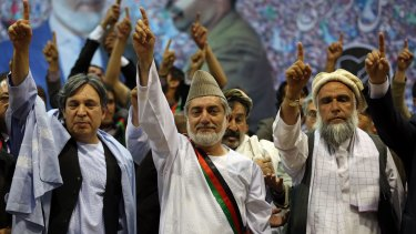 """Then presidential candidate Abdullah Abdullah, centre, is now the country's """"chief executive"""", second only to the president."""