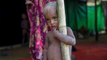 A Rohingya Muslim boy, who crossed over from Myanmar into Bangladesh, stands near a newly built shelter at Balukhali.