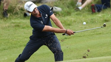 Adam Scott plays a bunker shot on the 15th hole during the final round of the 2012 British Open