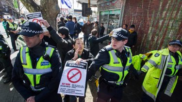 Police at the rally in Richmond for a safe injecting room.