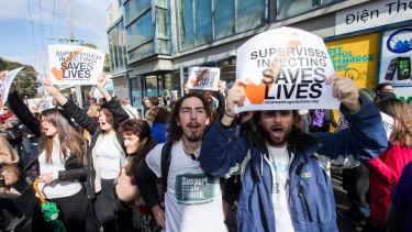 Protesters rally in Victoria Street, Richmond, for a safe injecting room.