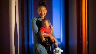 Liberian-born mother Geryline Conto with her five-month-old son Ownzie Flomo.