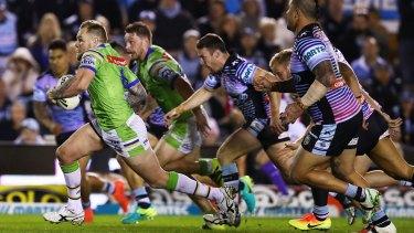 Blake Austin breaks the Sharks' defence.