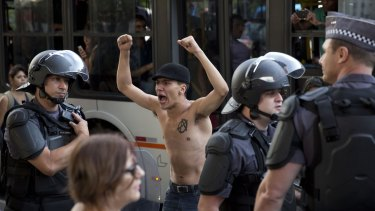 A demonstrator shouts anti-government slogans against the rationing of water during a protest in Sao Paulo.