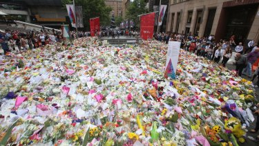 Martin Place is covered in thousands of floral tributes.