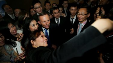 Tony Abbott poses for photos with members of the Sydney Young Chinese Business Association.