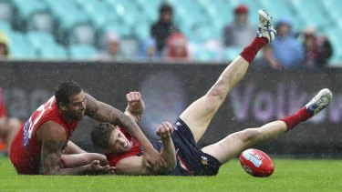 Wet and wild: Lance Franklin tackles Sam Frost.