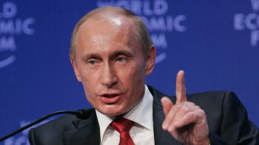 Strong ties: Russian President Vladimir Putin speaking to business leaders at the World Economic Forum during the global financial crisis