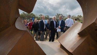 Malcolm Turnbull views Jorg Pilkat's <I>Divided Planet</i>.