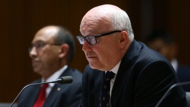 Department of Foreign Affairs and Trade secretary Peter Varghese  and Attorney-General George Brandis appear at a Senate estimates hearing.
