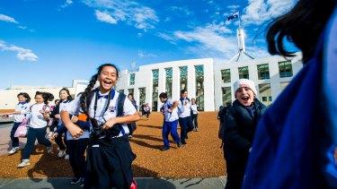 Year 5 and 6 students from from St Mel's Catholic school in Sydney outside Parliament while on an excursion.