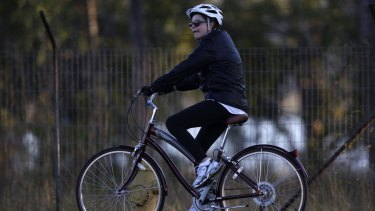 Brazilian President Dilma Rousseff rides her bicycle near the Alvorada Palace in Brasilia last week.