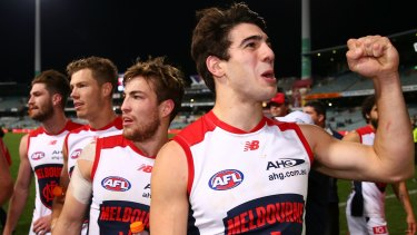 Christian Petracca, celebrating after beating the Eagles, is one of a long list of versatile midfielders and utility players at the Demons.