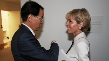 Foreign Minister Julie Bishop with Chinese ambassador Cheng Jingye. Former ambassador Geoff Raby says China policymaking has been shifted from the Department of Foreign Affairs.