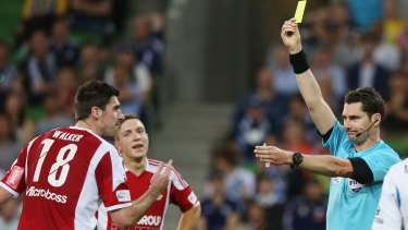 Bradley Walker of Hume City reacts after receiving a yellow card following a contest with Besart Berisha which led to a penalty.