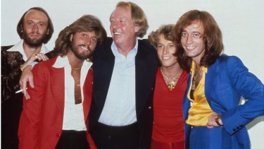 The Bee Gees: brothers Maurice Gibb, Barry Gibb, manager Robert Stigwood, Andy Gibb and Robin Gibb in New York, 1979.