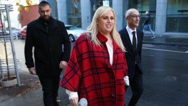 Rebel wears tartan: Rebel Wilson appears outside court.