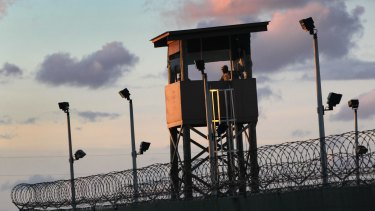 A military guard tower stands on the perimeter of a detainee camp at the US detention centre for 'enemy combatants' in Guantanamo Bay in 2010.