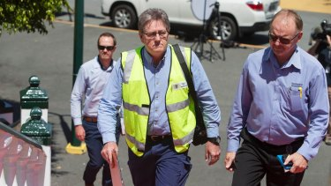 Saftey officers arrive to inspect the ride at Dreamworld on Wednesday.